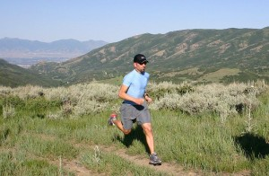 A ultramarathoner running the 32 Mile Wyoming Ultramarathon in the Bighorn Mountains