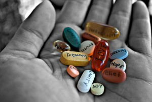 colored pills labeled with positive words